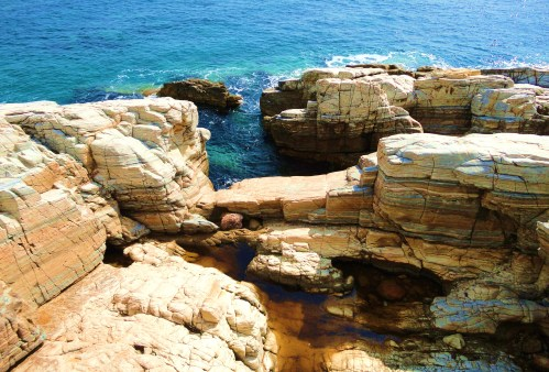 Rocky seashores,deep blue waters